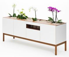 London-based JiB design studio, headed by Je-Uk Kim, is about to launch two new pieces of furniture at 100% Design in London this month. While the company works in various aspects of design from architectural to product, their furniture is truly sublime. Inspired by your basic indoor garden, they decided to combine modern and useful storage pieces with sunken gardens on top making each practical and beautiful.