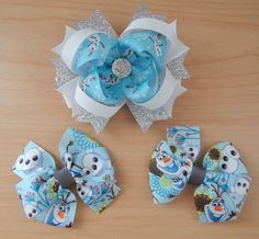 """This beautiful Olaf hair bow set will melt your heart! The over the top hair bow which measures approximately 4"""" and it's just adorable. The ribbon of the top bow has happy Olaf all over with a sparkl"""