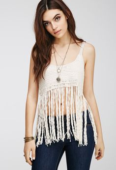 """Thicker crochet gives this sleeveless crop top its boxy, structured shape, while swishy strands of fringe add a little shimmy.  Lightweight knit Shell: 84% cotton, 16% rayon 15"""" - 27.5"""" full length, 32"""" chest, 33"""" waist Measured from Small Made in China"""