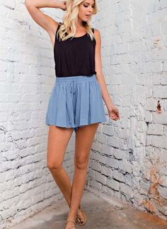 Flowy, comfortable, and easy to wear high-waist shorts with smocked waistband and spaghetti tie in the front. This short pant was made with a lightweight rayon crepe fabric. Model wearing small, true