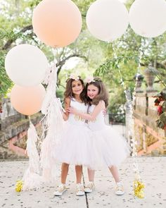 Cute should always include comfort! Dress your flower girl in a giant tulle skirt with gold Converse sneakers for a cute outfit contrast while walking down the wedding aisle.