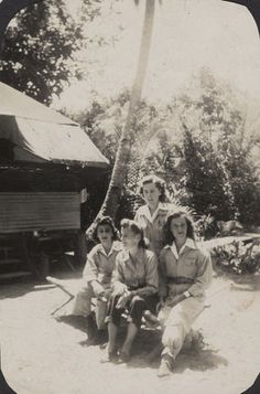 Four flight nurses from the 801st Medical Air Evacuation Squadron pose together in Guadalcanal in 1944