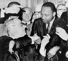 President Lyndon Johnson handing a pen to Martin Luther King Jr at the signing of the Voting Rights Act (1965)