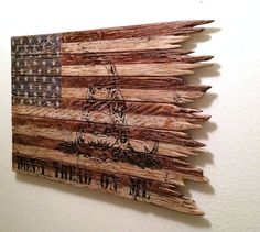 ***I currently have a three to four week week turnaround time ***  This American flag is a BellaRemi Designs original. It is truly a one of a kind American flag with the Gadsden Dont Tread on Me logo incorporated. It is crafted from hand-selected reclaimed wood, then hand-painted and distressed to give it a tattered, ragged, rustic, and antique appearance. The wood selected for this flag is the cream of the crop when it comes to reclaimed wood. One cannot find this wood in a hardware/home…