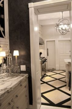 LOVE this floor for our master bath. Matches our monogrammed black and white bedspread.