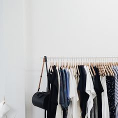 Neutral-toned clothing rack.