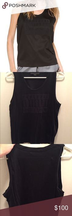 """Alexander Wang Parental Advisory Tank Top Alexander Wang Parental Advisory muscle tank. Women's size S. Made to be worn slightly oversized. Only worn a few times. In great condition. Clean.  SCOOP NECK MUSCLE TANK WITH TONAL BONDED PARENTAL ADVISORY LOGO AND WELDED SEAMS. THE PARENTAL ADVISORY LOGO IS BONDED ONTO THE FRONT. THIS ITEM RUNS TRUE TO SIZE AND HAS A RELAXED SILHOUETTE. 100% COTTON. 24"""" (61CM) LONG. NO TRADES. ALL OFFERS PLEASE USE BUTTON. Alexander Wang Tops Tank Tops"""