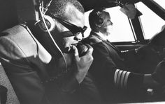 """Caption from LIFE. """"In his 50-seat private plane, Ray talks to a control tower. He likes to sit up in the co-pilot's seat and knows so much ..."""