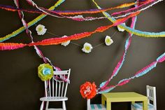 Ruffled-Streamer-Backdrop. Look at the flower on the chair. These paper flowers are so whimsical.