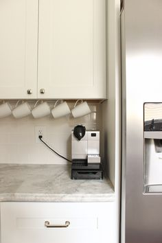 Hang Mugs On Hooks Underneath Your Cabinets To Get Them Out Of Cupboards Increasing