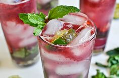 Triple Berry Mojitos (6-8 fresh mint leaves    2 1/2 ounces of mint simple syrup    1 ounce of rum    1 1/2 ounces of club soda    2 ounces of mixed berry juice    the juice of one lime    fresh strawberries, blueberries and raspberries)