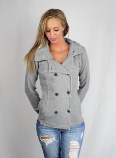 The picture speaks 1,000 words for this adorable style.  Thinking outside the traditional hoodie box, we designed this juniors pea coat for those ladies with a sense of fashion. Featuring a double breasted button closure, self fabric collar and cuffs, removable hood, shoulder epaulettes, front & ...