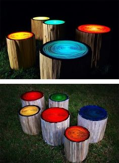 Tree stumps painted with glow in the dark paint Perfect for a backyard!