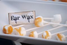 Ear wax treats made with marshmallows and caramel and more marshmallow treats....great for a Halloween party.