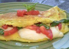 Caprese Omelette With Eggs, Fresh Mozzarella Cheese, Tomatoes, Fresh Basil, Olive Oil, Pepper, Salt