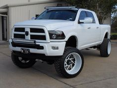 Dream Truck!! 2013 White and Black Dodge Ram with two off road light bars