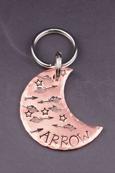 Moon Dog Tag - Arrows and Stars  Your dog will love wearing this cosmic moon tag adorned with flying arrows and stars. This original pet tag is handcrafted at The Dancing Hound's studio, and is perfect for dogs and large cats! Each tag is handmade to order just for you. #thedancinghound Dog Name Tags, Dog Id Tags, Pet Tags, Just In Case, Just For You, Custom Dog Tags, Jewelry Polishing Cloth, Unique Animals, Star Designs