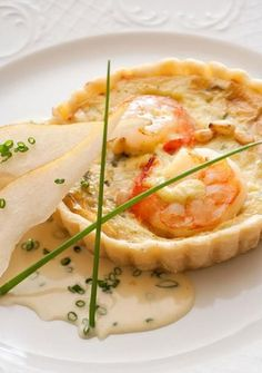 Mmmm. This Stilton-Shrimp Tart is served in a flaky pastry shell with a Chive Beurre Blanc sauce. - Traditional Home ®/ Photo: John Bessler