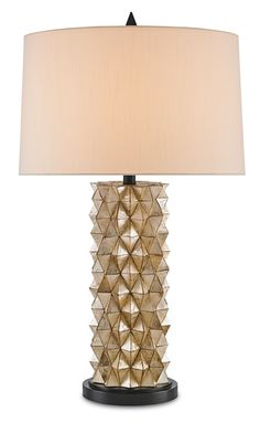 Currey & Co.'s Cloister Table Lamp is truly unique. Its faceted column base is formed by the artful arrangement of glimmering capiz shells. The play of light is amazing, and the lamp is finished with a shantung silk shade. This was one of Creative Director Mark Stuart's great finds from the Atlanta Market, and you will find it in our showrooms soon.