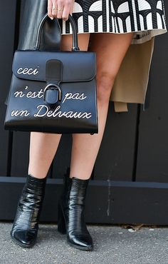 A Delevaux bag sends a strong message on the PFW streets.