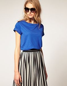 Another looks with simple, larger T shirt. make sure the T shirt is fitted somewhere. Like the shoulders here. Find a long skirt that fits the waist - alter it and add a thick waist band if needed. Tuck into the skirt. Make sure the fall of the skirt and the hem hit just above the floor. Not to flowing, needs some weight.