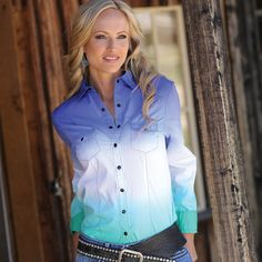 An authentic western shirt has added personality as shades of purple and green fade into white in this colorful double dip-dye button-up. A rich purple color covers the top and shoulders, while a bursts of white lightens the middle section of the shirt and fades into a light green at the bottom. Matte black snaps and double-front pockets add the final touches to this colorful western button-up.   CTW9360001 AST