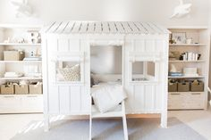 """Designed for adventure. Amanda S. Gluck, lifestyle blogger of fashionablehostess.com, reveals the """"big boy room"""" she designed for her son with RH Baby & Child. Featuring our Cabin Bed, Mali Print Ultra-Fine Organic Cotton Lines Bedding Collection, RH TEEN Laguna Bookcases and Papier-Mâché Sharks."""