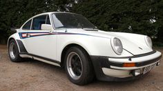 Porsche 911 3.0 Turbo Drinks brand Martini has a long history of sponsoring racing Porsches. Its livery was also available on some roadgoing models, such as this 1977 Turbo