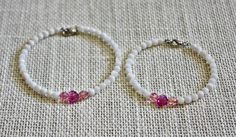 Mother Daughter Swarovski Fuchsia Heart and Oyster Shell Bracelet Set $30.00  Don't forget to pick up these beautiful dainty mommy and daughter bracelets for that special occasion in your life or just for every day wear.  These bracelets are made with 3 to 4 mm oyster shell beads, 6 mm rose ab Swarovski crystal faceted round beads and an 8 mm fuchsia Swarovski crystal face...