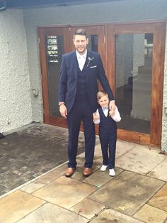 Spring Wedding - Groom in navy suit with white tie and tan Chelsea boots - Page Boy in navy suit blue floral bow tie and matching pocket square and converse - Groomsmen in navy suits blue ties and tan Chelsea boots - blue - powder blue - vintage wedding - Wedding Day outfit - suits - clothing