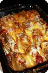 Taco Stuffed Shells ~ There is a little cream cheese added to the meat mixture which makes this dish creamy and luscious. Have fun with toppings of your choice, sour cream, olives, green onions, crushed chips, you name it
