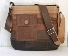 """made out of a patchwork of recycled brown leather.  It measures 12"""" wide x 11"""" high. It has an adjustable 1 1/2"""" x 46"""" long patchwork leather strap"""