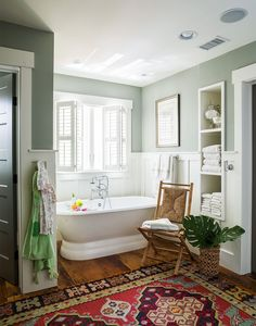 Modernize an earthy green paint color by including dark and light counterpoints in the room. The pale leaf green wall color, combined with white fixtures and linens, inspires serenity in this bathroom #paintcolors #greenpaintcolors #paintcolortrends #bhg Mold In Bathroom, Bathroom Spa, Bathroom Interior, Bathroom Ideas, Green Bathroom Decor, Bathroom Marble, Master Bathroom, Neutral Bathroom, Industrial Bathroom