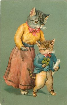 mother cat stands behind kitten who is holding shamrock & a scroll