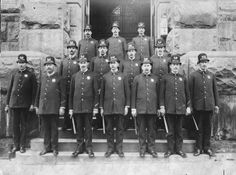 An undated photo of officers outside the old Grand Rapids Police Department Headquarters on Crescent Street NW, at Ottawa Ave.