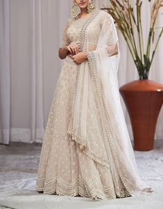 Buy Ivory Organza Cutdana Work Lehenga Set by ANUSHREE REDDY Available at Ogaan Online Shop