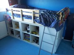IKEA Hackers: An EXPEDIT Bed for kids!    Materials: 2 2x2 EXPEDIT, MALM, SULTAN LURÖY, SULTAN HUGLO    Bed frame is also attached to wall.  Could go double tall?  A little play space underneath?