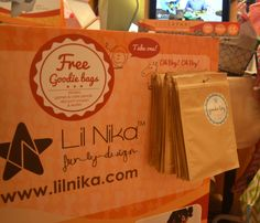 """""""Please take a free Goodie Bag!  It has stickers, games, coupon and leaflets in there!""""   19 May, Lil Nika at the Prestige Fair 2014 @ Conrad, Hong Kong."""