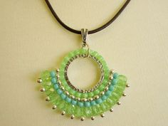 Free beading jewelry tutorial to make this brick stitch shape. Great step by step pictures and did I mention it's free!