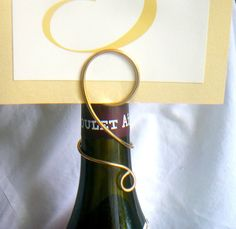 Wine Bottle Sign Holder Elevate Your Table by HomesAndWeddings