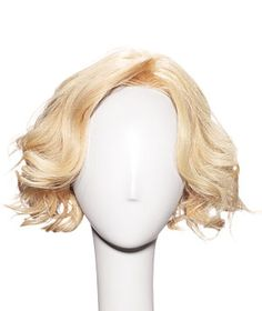 Looking for a low-maintance haircut? Ask your stylist for a jaw-length blunt cut with long, side-swept bangs. (Remember Carrie Bradshaw at her book party?)