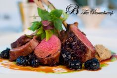 Rare lamb chops with olives and balsamic sauce