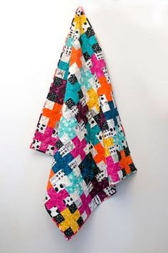 Tisha from Quilty Therapy created her Charming Plus Quilt with the Avant Garde fabric collection. The basic nine patch block gets a little something extra in Tisha's design, making it a satisfying pro