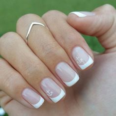 French gel manicure with mini anchor art