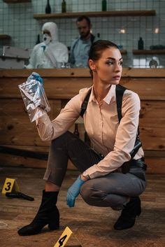 female detective collecting evidence by LightField Studios on Detective Outfit, Police Detective, Perito Criminal, Mein Job, Detective Aesthetic, My Future Job, Enola Holmes, Criminology, Dark Photography