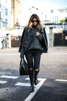 Emma Hill wears grey cable knit chunky sweater, black leather biker jacket, washed black ripped knee skinny jeans, studded Givenchy Antigona bag, studded Givenchy buckle ankle boots, edgy winter outfit