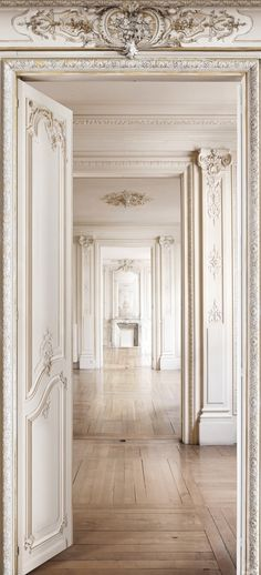 ornate door frames. gorgeous! i'd love to eventually buy and restore an old home one day - tin tile ceilings, beautiful woodwork, claw foot tubs...