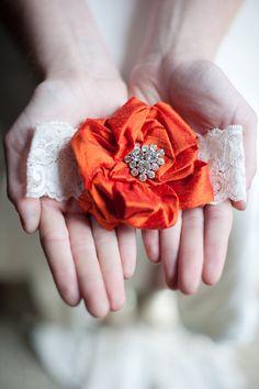 Orange flower garter. Emily Riggs.