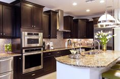 Some Suggestions When Using Espresso Kitchen Cabinets At Home http://www.cabinetdiy.com/suggestions-for-using-espresso-kitchen-cabinets #kitchencabinets #kitchen #cabinets