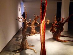 Tjanpi Desert Weavers 2013 'Minyma Punu Kungkarangkalpa (Seven Sisters Tree Women) woven using native grasses, found fencing wire, acrylic pillow stuffing, yarn, twine, raffia, plastic bags, feathers, wool, tree branches, foam and piping at MCA, Sydney